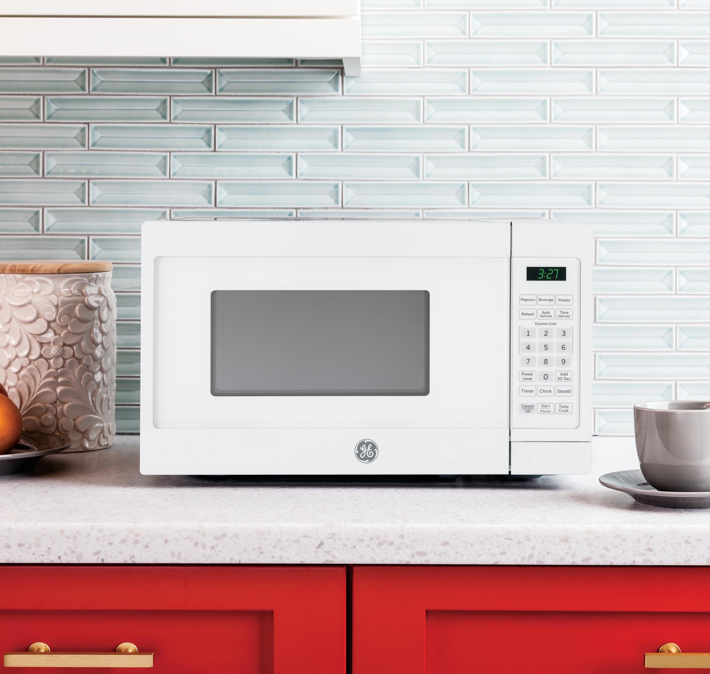 Diferentes maneras para colocar horno microonda en la - Donde colocar tv en cocina ...